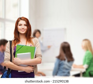 education, technology and people concept - smiling student with bag, folders and tablet pc computer standing in class
