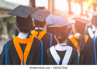 Education theme concept. Back view of Graduates during commencement.