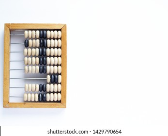 Education, training and account concept. Old wooden abacus on pure white background