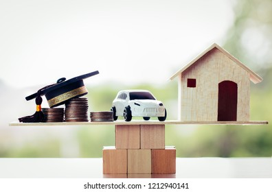 Education university success Concept : House car graduation cap on wooden block, concept of Educate graduate requires saving money, Successful will bring home cars, become balance everyone life needs