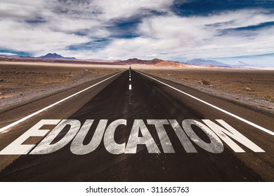 Education written on desert road