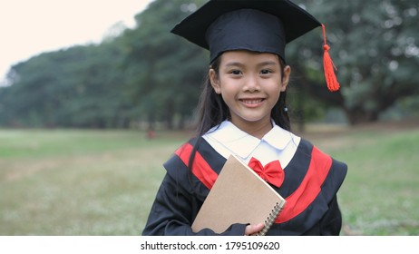 Educational concepts. Little graduates are happy to study.