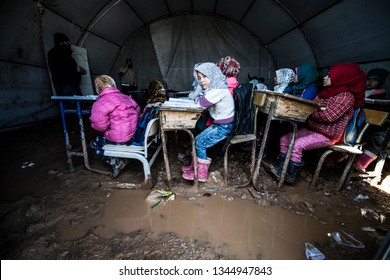 Educational conditions of children in Azez, Syria. They take lessons in tents. places in water and mud. Azez town located on the border of Turkey and Syria. 25 FEBRUARY 2019. Syria at Azez