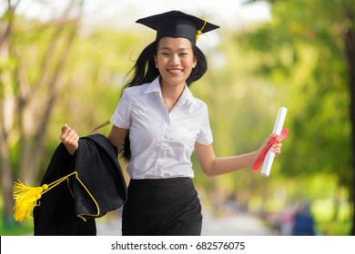 Educational theme.Happy woman graduating holding her diploma and smiling.
