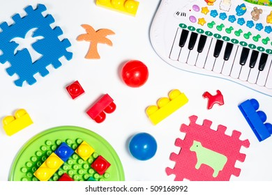 Educational toys for babies balls, mats, building blocks, piano isolated
