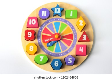 An educational wooden jigsaw clock toy for children