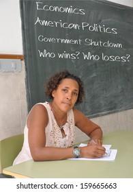 Educator Teacher Professor Economics American Politics Classroom Blackboard Government Shutdown Who wins? Who loses?