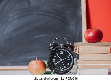 Eduction concept. Alarm clock and book