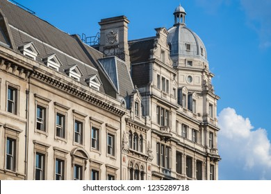 An Edwardian Baroque architecture building with domed corner rooftop pavilions around Parliament Square in London