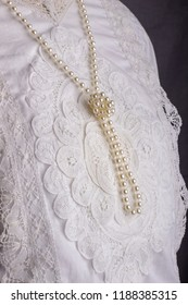 Edwardian lace blouse detail with pearl necklace