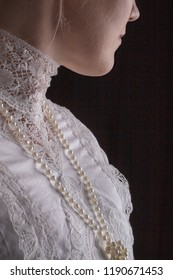 Edwardian lady in white lace blouse