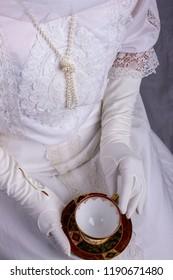 Edwardian lady in white lace blouse