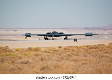 "EDWARDS AFB, CA - OCT 17: Northrop Grumman B-2 Spirit ""Spirit Of New York"" landing at Flight Test Nation 2009, October 17, 2009, Edwards Air Force Base, CA"