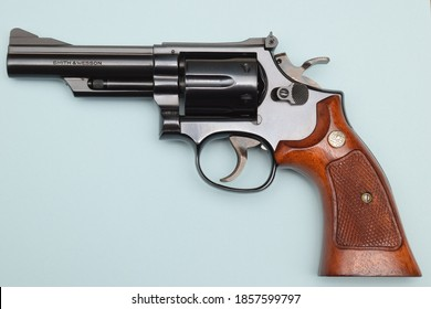 """Edwardsville, IL-4/11/2016: Smith & Wesson revolver made in 1979. Blue-steel, .357 caliber, 4"""" barrel on blue background. At one time, the .357 magnum was the most powerful handgun available."""