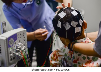 EEG electrode placement to patient during EEG record, Electroencephalogram (EEG)