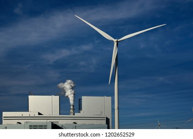 eemshaven port, groningen/netherlands - october 12, 2018:  eemshaven energy park, rwe 1,560 mw coal power plant and a wind power generator unit