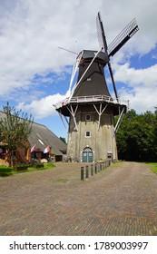 Eenrum, the Netherland - July 15, 2020: Historical Dutch flour mill 'De Lelie' against a clouded sky.