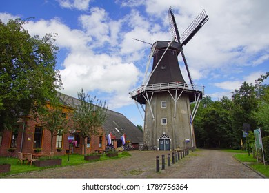 Eenrum, the Netherland - July 15, 2020: Historical Dutch flour mill 'De Lelie' and the entrance of the mustard museum in the town of Eenrum.