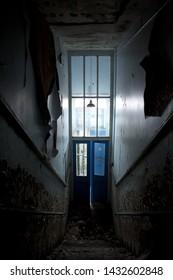 Eerie Staircase of Abandoned School, Derelict Building, Decaying Hallway