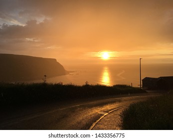 Eerie sunset in drizzly conditions, Gardenstown, Scotland.