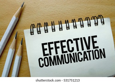 Effective Communication text written on a notebook with pencils