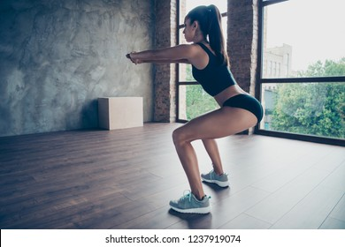 Effective enduring training. Profile side view of nice beautiful focused strong powerful sportive slim lady model with perfect figure lines doing sit-ups hands stretching forwards