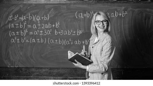 Effective teaching involve acquiring relevant knowledge. Woman teaching near chalkboard in classroom. Qualities that make good teacher. Effective teaching involve prioritizing knowledge and skills.