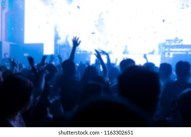 Effects blur Concert, disco dj party. People with hands up having fun
