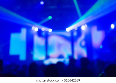 Effects blur: Concert dj disco club party. People with hands up having fun