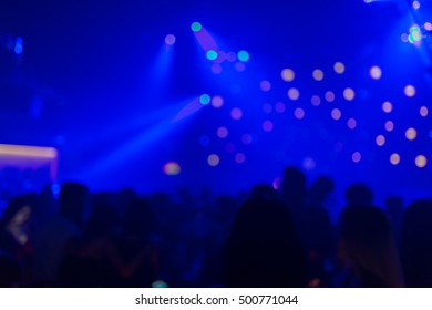 Effects blur Out-of-focus  Concert, disco party. People with hands up having fun