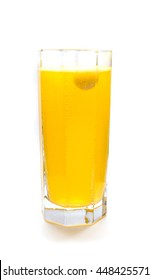 Effervescent orange tablet dissolving with bubbles in glass of water