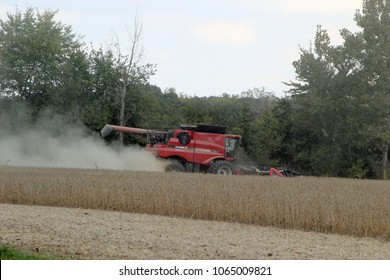 EFFINGHAM, IL - OCTOBER 10: A modern combine harvester working on a crop 2013