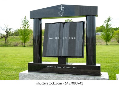 """EFFINGHAM,ILLINOIS - MAY 6, 2019 - The Ten Commandments marble plaque with the words """"You shall not steal"""""""