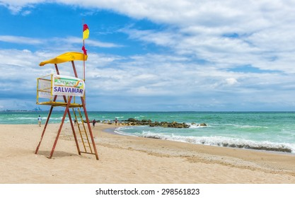 EFORIE NORD, ROMANIA - JULY 04, 2015: Old lifeguard tower on romanian beach of Black sea with flags showing wind intensity and wavy waters
