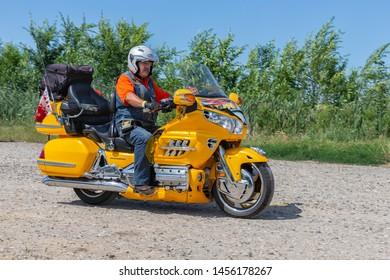 Eger, Hungary - July 04, 2019: Motor biker at yellow Honda Goldwing making a drive through Hungary between Budapest and Eger