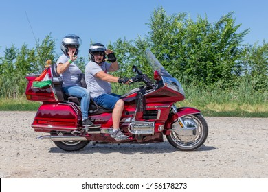 Eger, Hungary - July 04, 2019: Motor bikers at red Honda Goldwing making a drive through Hungary between Budapest and Eger