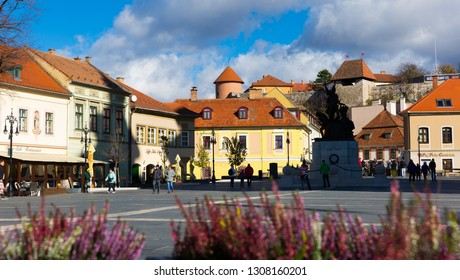 EGER, HUNGARY - OCTOBER 30, 2017: Eger central square with monument to Dobo Istvan and fortress on background