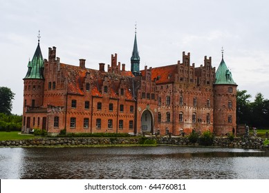 Egeskov Castle in Odense, Denmark on a cloudy day