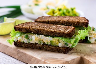 Egg and avocado sandwiches with cream cheese for healthy breakfast