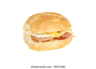 Egg and bacon bread roll isolated on white