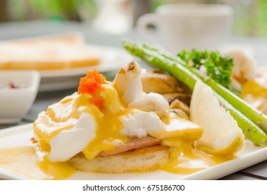 egg benedict with crabs meat  asparagus on blur-ed background