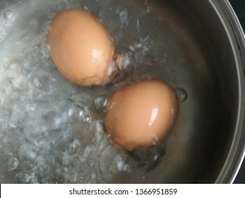 Soft‑boiled egg. Boiled egg in pan. hot water is boiling.