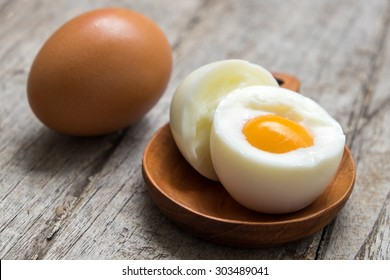 Egg boiled in wooden containers on wooden floor