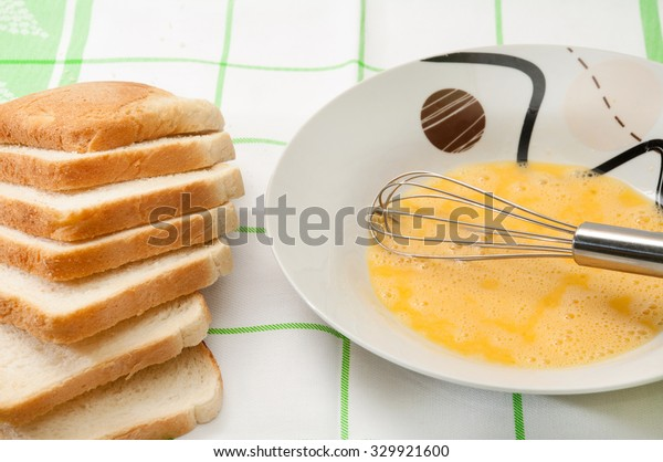 Egg and bread prepared for french toast.