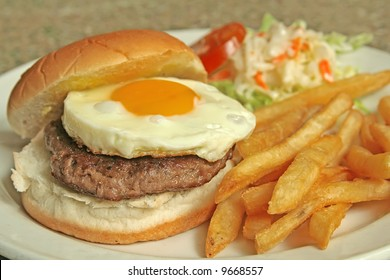 Egg Burger with french fries and coleslaw