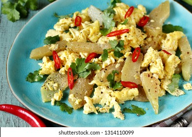 egg chayote in mexican style. whipped eggs are fried with chopped chayote with cilantro and spicy chili. recipe with chayote. top view. Mexican food