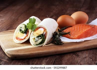 egg cheese and salomon sandwich wrap in tortilla