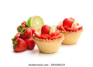 Egg custard  tarts with fresh strawberry and lime isolated on white