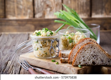 Egg dip sandwich with spring green onion for healthy and delicious brunch on rustic wooden chopping board