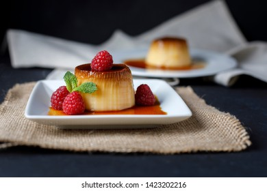 Egg flan with raspberries and mint leaves